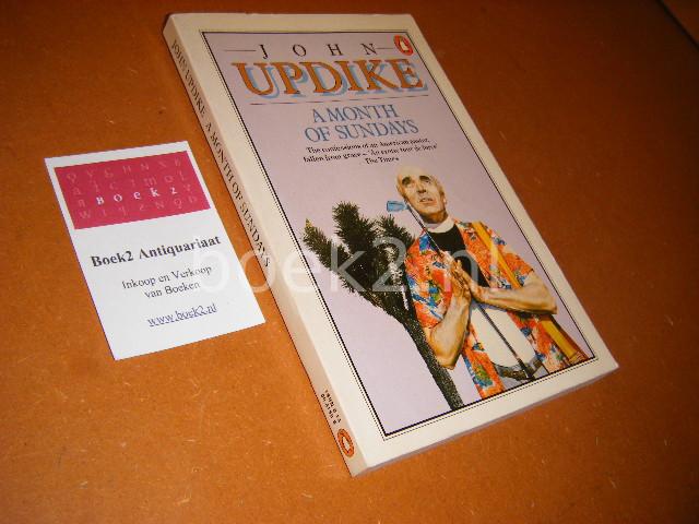 UPDIKE, JOHN. - A Month of Sundays